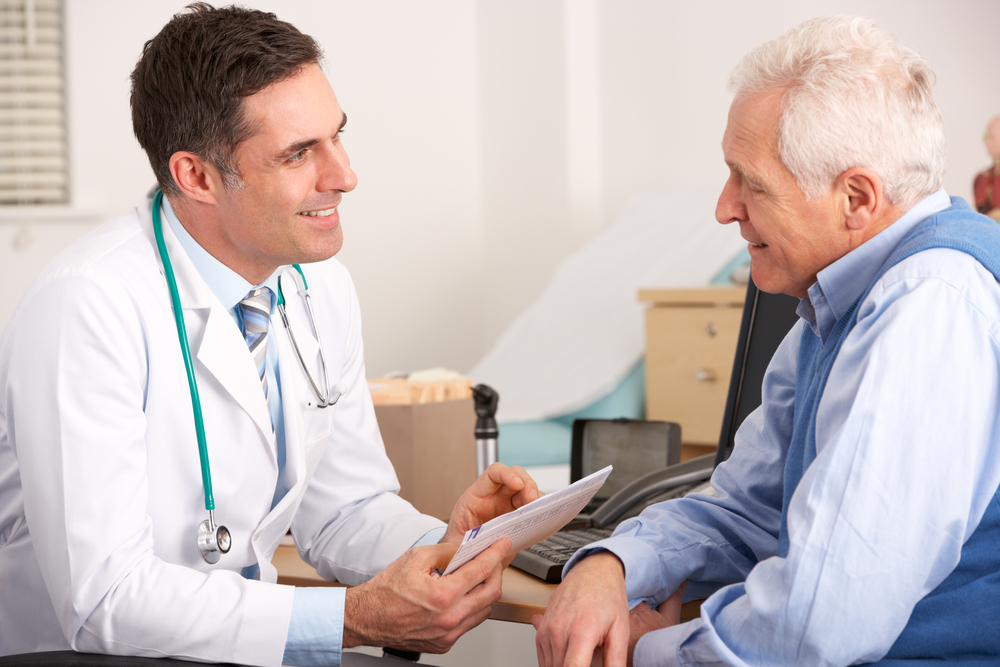 Doctor at Florida Hospital with older patient