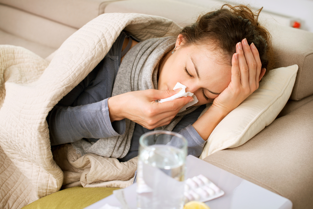 Woman struggling with the common cold