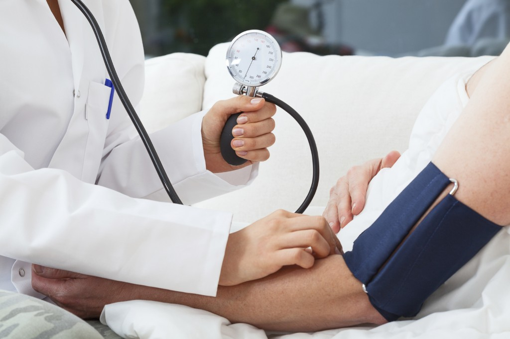 Woman discusses new hypertension medication with her doctor