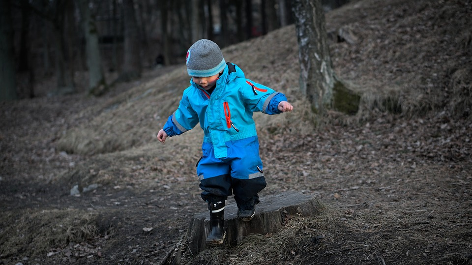 kid with juvenile arthritis walking in the woods