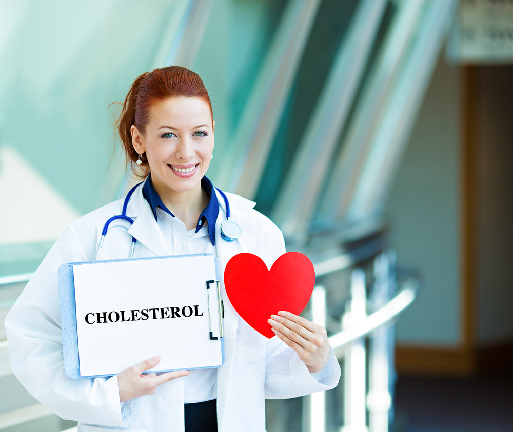 """physician holding a sign reading """"cholesterol"""" to raise awareness about good cholesterol and bad cholesterol"""