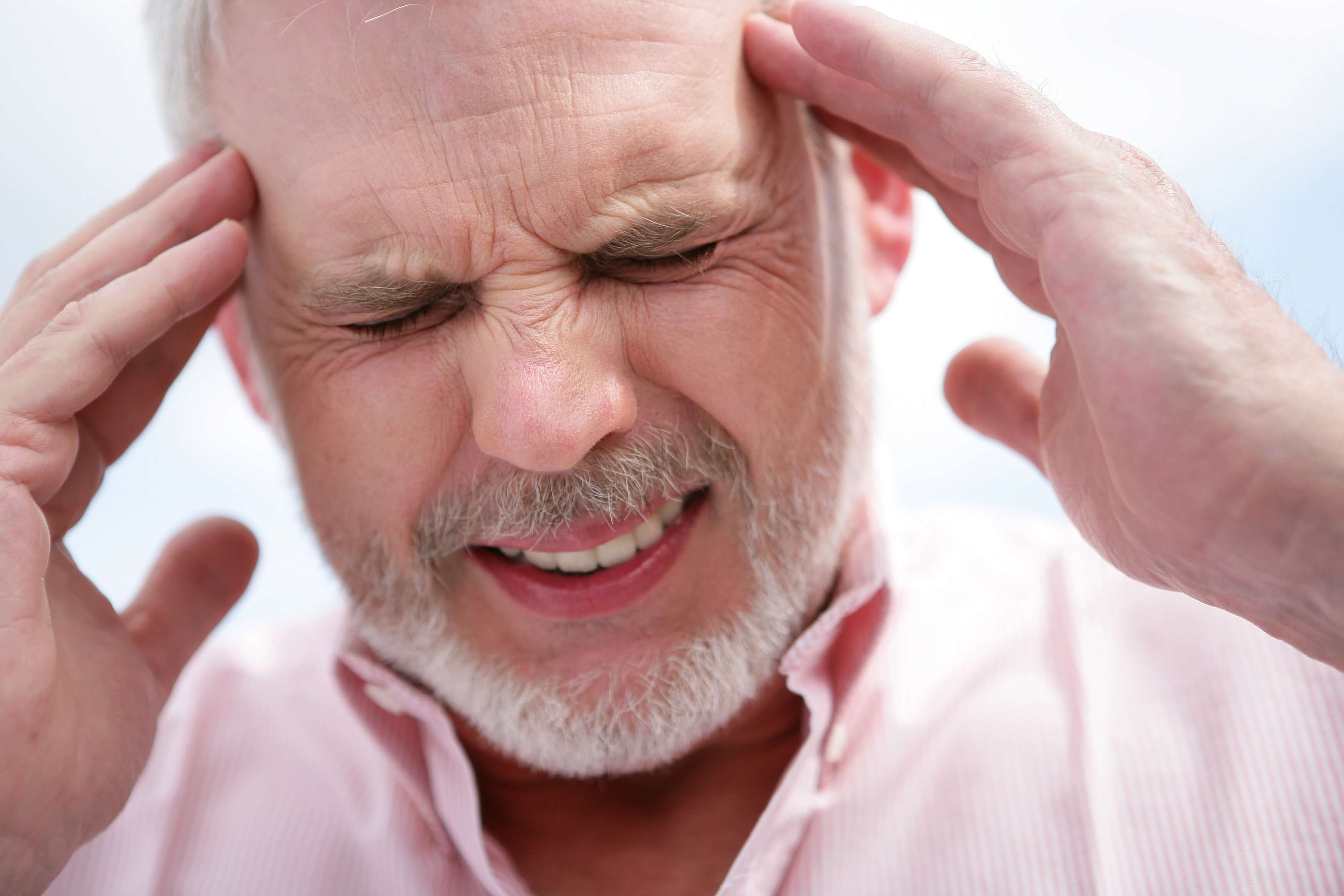 Man suffering from migraines takes part in a research study