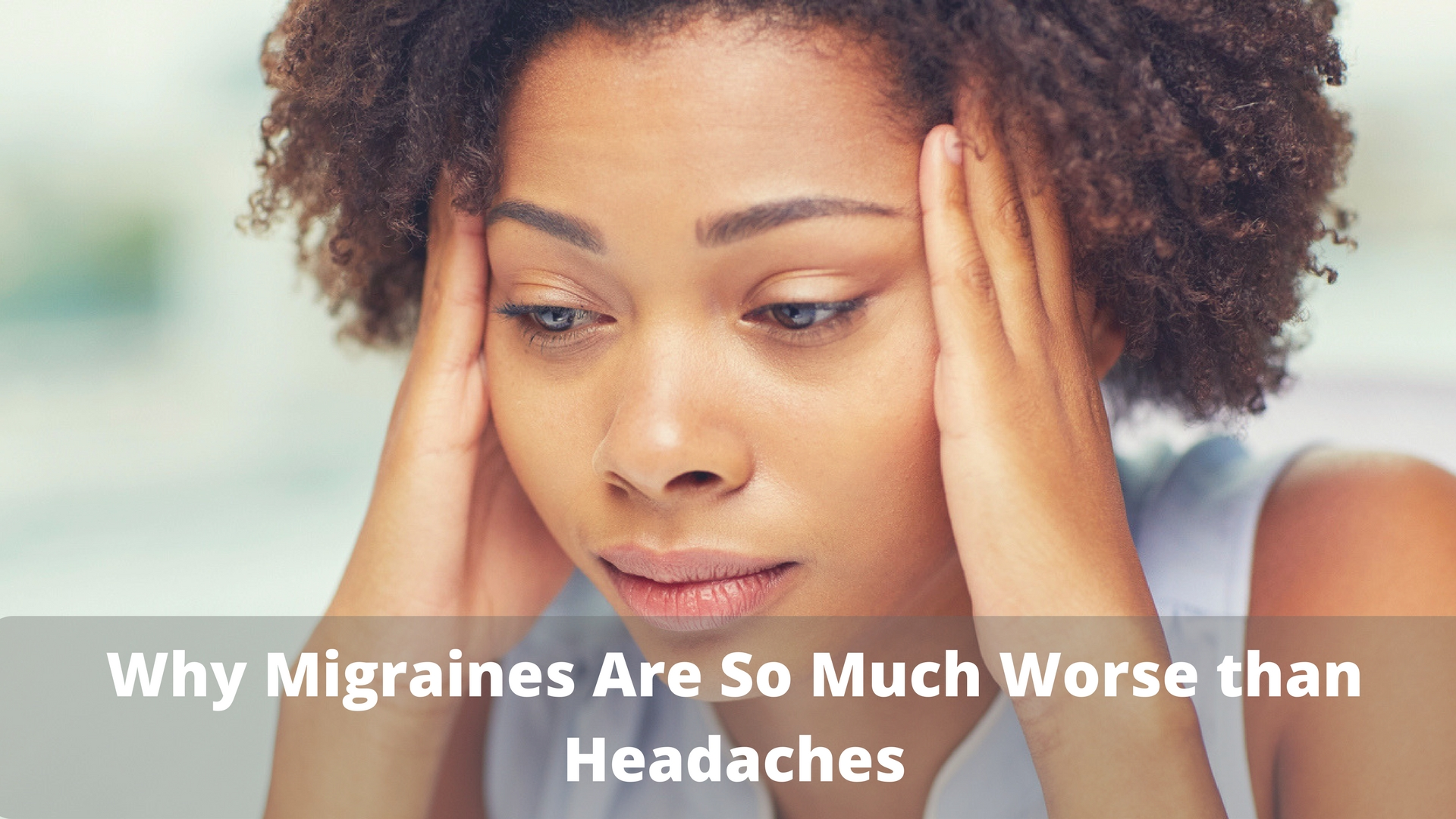 Woman suffering from a migraine headache at work